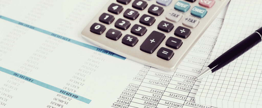 Calculator on top of financial documents